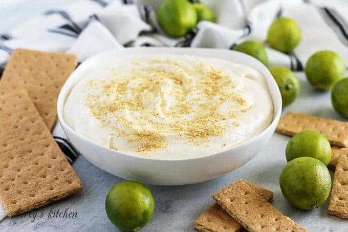 The finished key lime cheesecake dip served in a white bowl.
