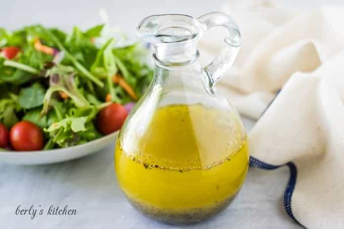 The homemade salad dressing recipe served in a glass cruet.