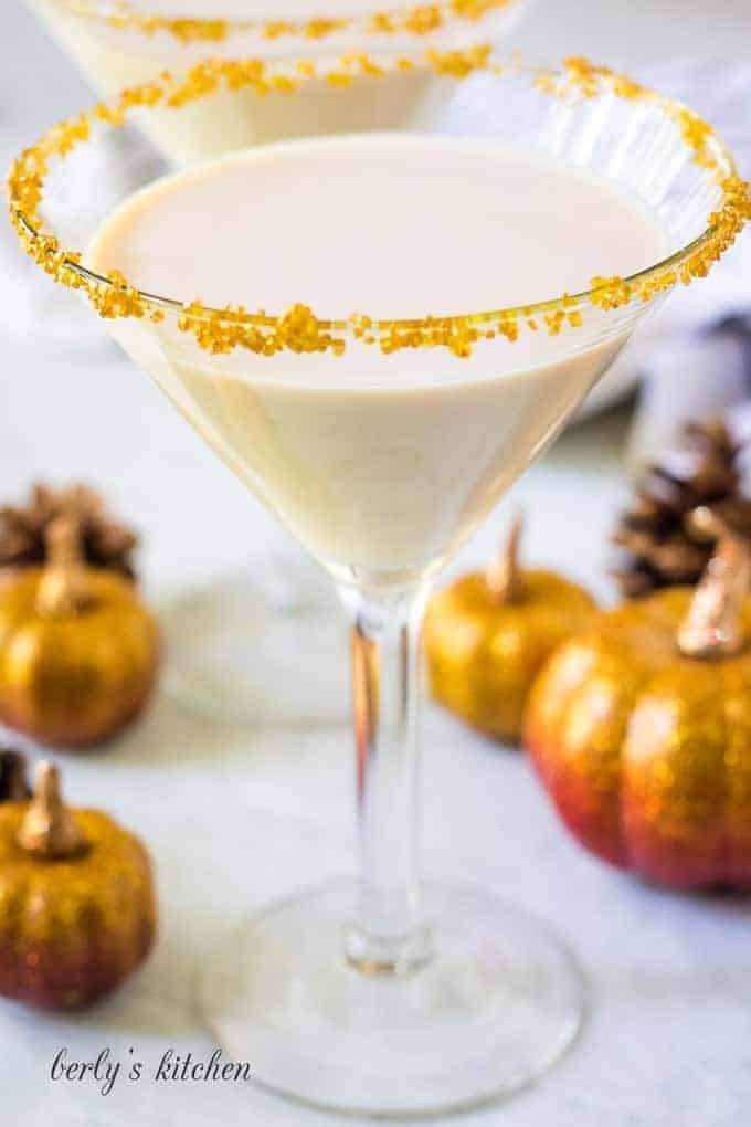 The creamy pumpkin martini served in a chilled, decorated glass.