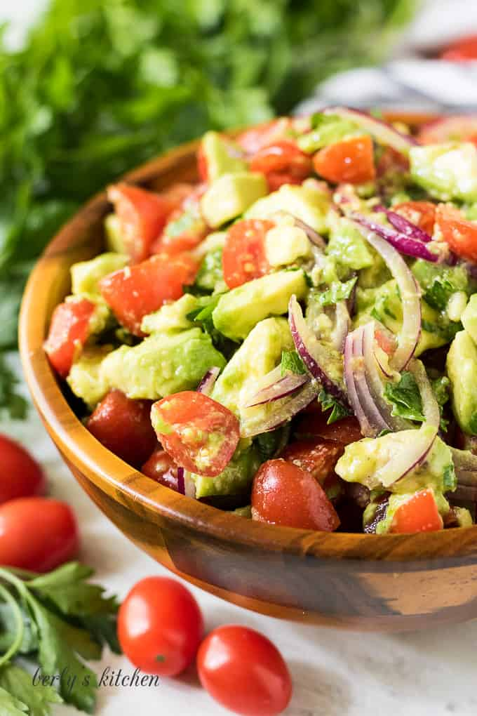 A close up view of the finished avocado tomato salad.