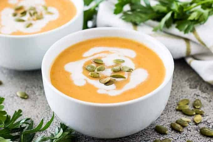 Acorn squash soup topped with toasted seeds and coconut milk.