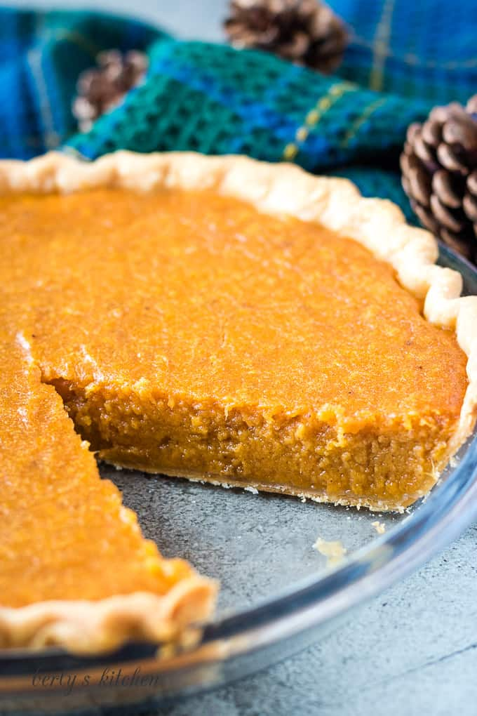 The sweet potato pie has been cut to show the inside.