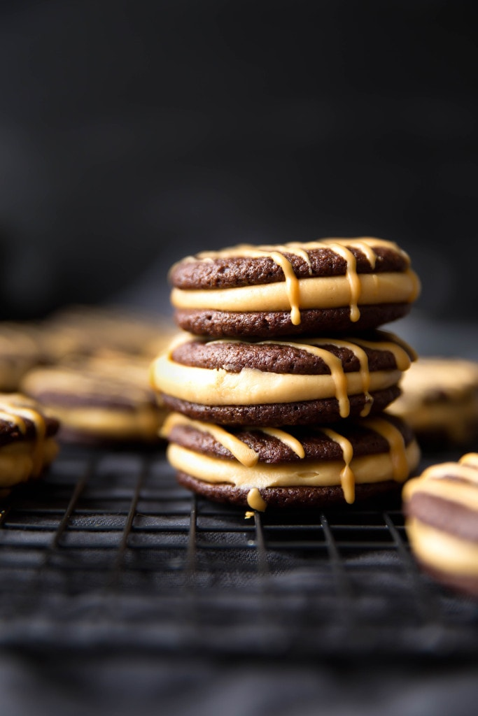 Dark Chocolate Peanut Butter Sandwich Cookies: a fluffy peanut butter frosting sandwiched between two brownie-like cookies.