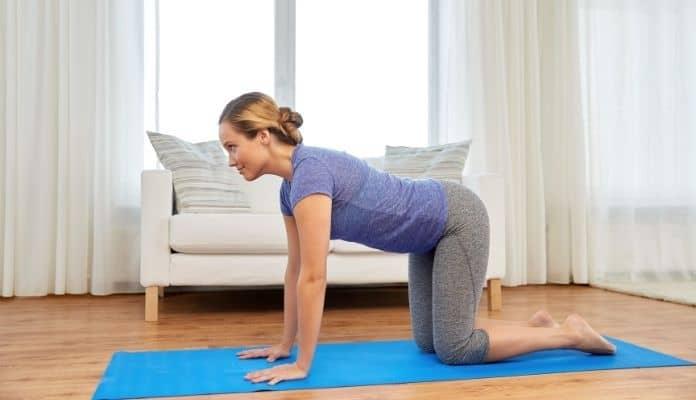 Woman doing yoga cow pose