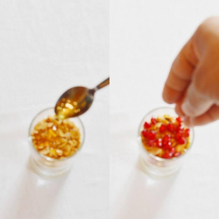 adding honey and fruits to make yogurt granola parfait.