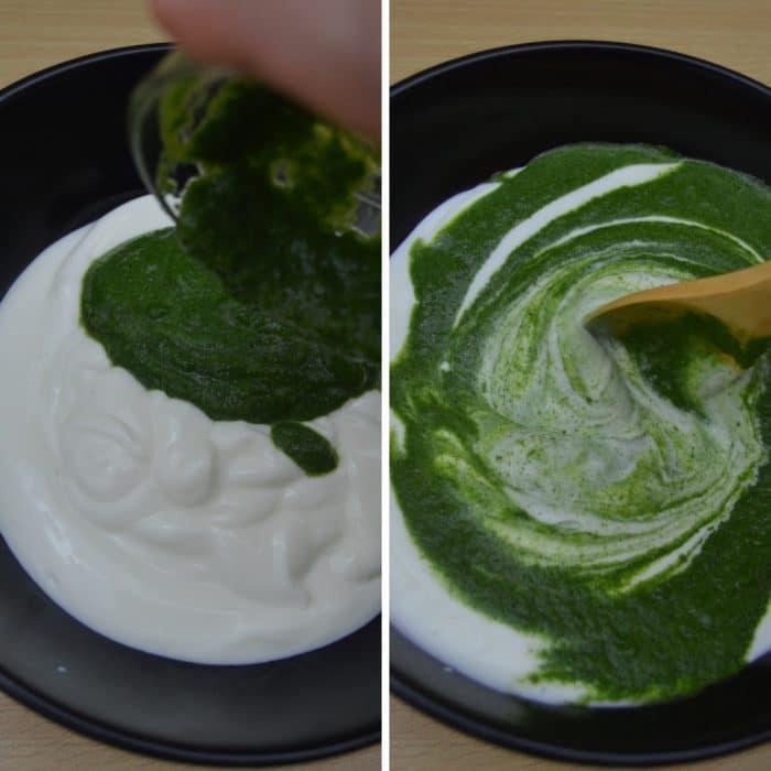 adding herb paste in yogurt and mixing