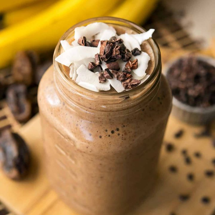 A delicious, naturally-sweetened, and healthy banana cacao recovery smoothie for helping you post-workout or after a rough night out.