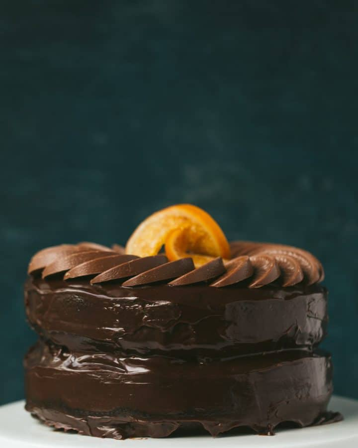 A 2 layer chocolate orange cake with a circle of Terry's chocolate orange segments decorating the top. There are 2 candied oranges in the centre.