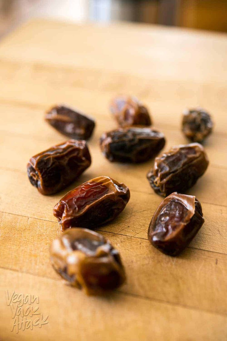 several medjool dates on a cutting board