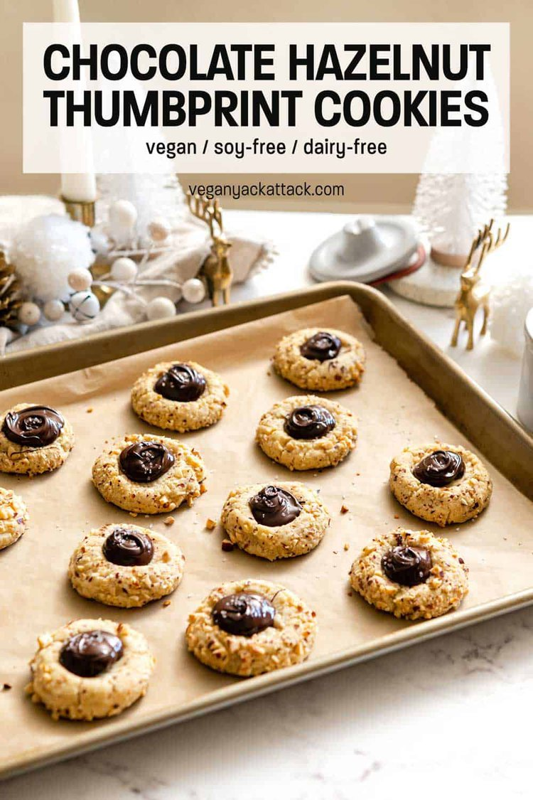 Sheet pan filled with chocolate hazelnut thumbprint cookies, and various Christmas decor