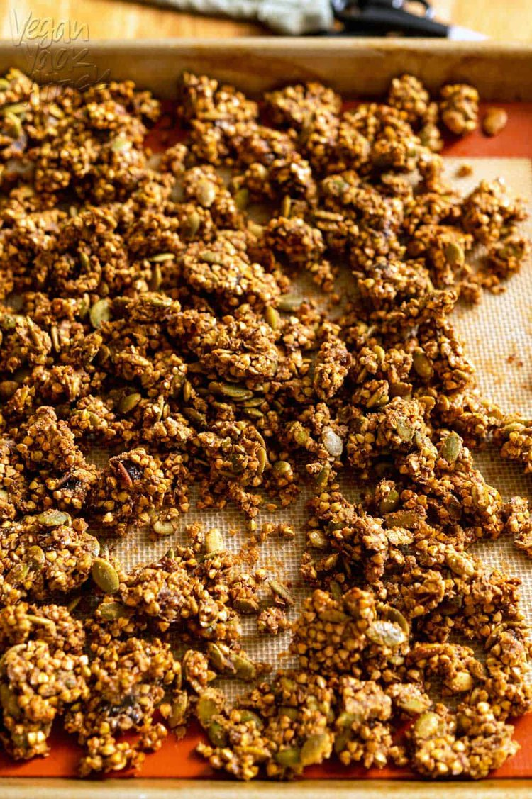 Buckwheat granola on baking sheet with silpat after baking