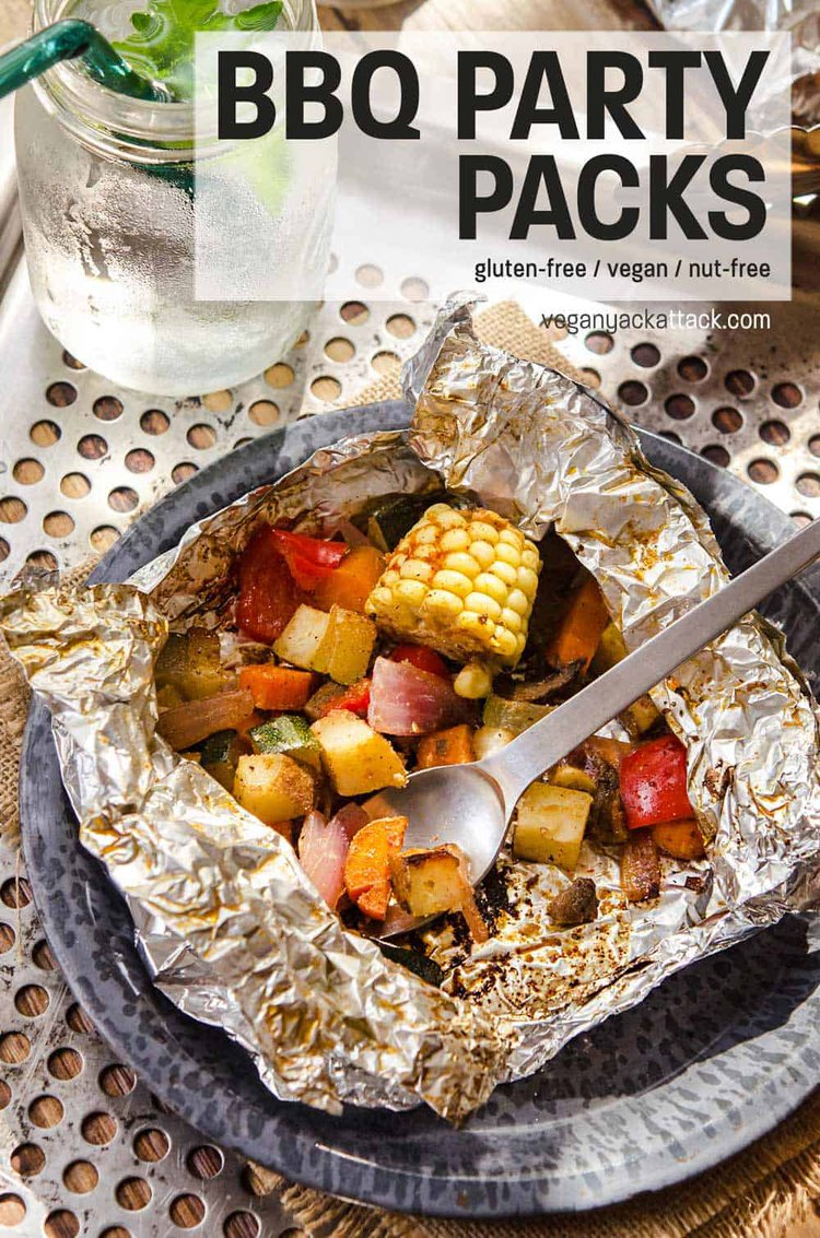 Foil, grilled, BBQ Party Pack opened up with veggies showing, being eaten with a spork