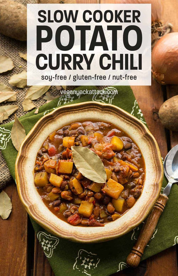Slow Cooker Potato Curry Chili in a stoneware bowl with green linen and wood table top