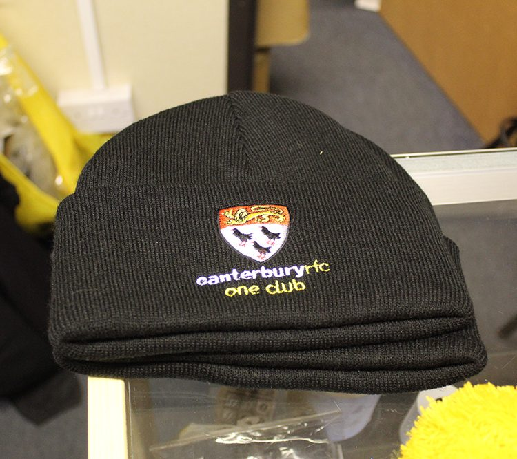 Plain black beanie available from the club store