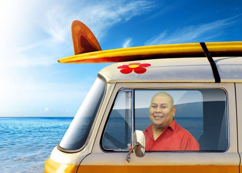 "A participant ""drives"" a VW Van on the beach in this Miami Green Screen Photo Booth"