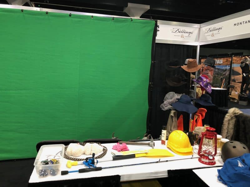 Green screen photo booth props on a table at an experiential photo marketing event.