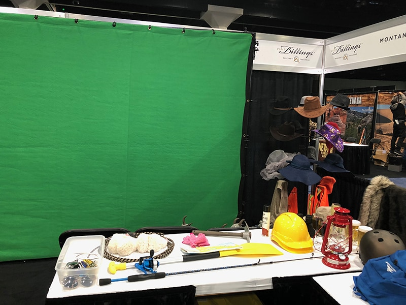 Houston green screen photo booth at Travel and Adventure Show. This is the prop table.