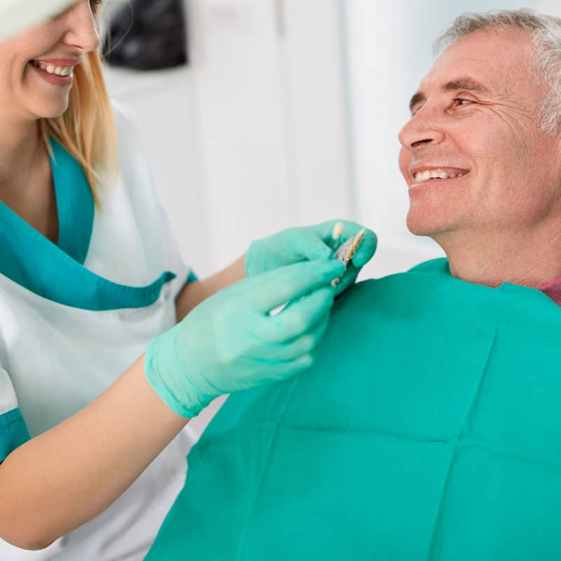 Smiling referred patient in chair