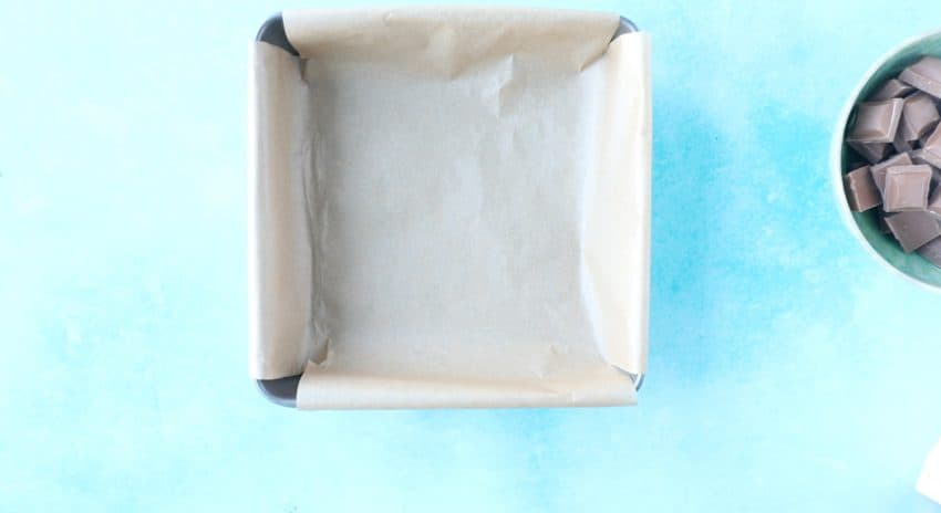 A square baking tin lined with baking paper