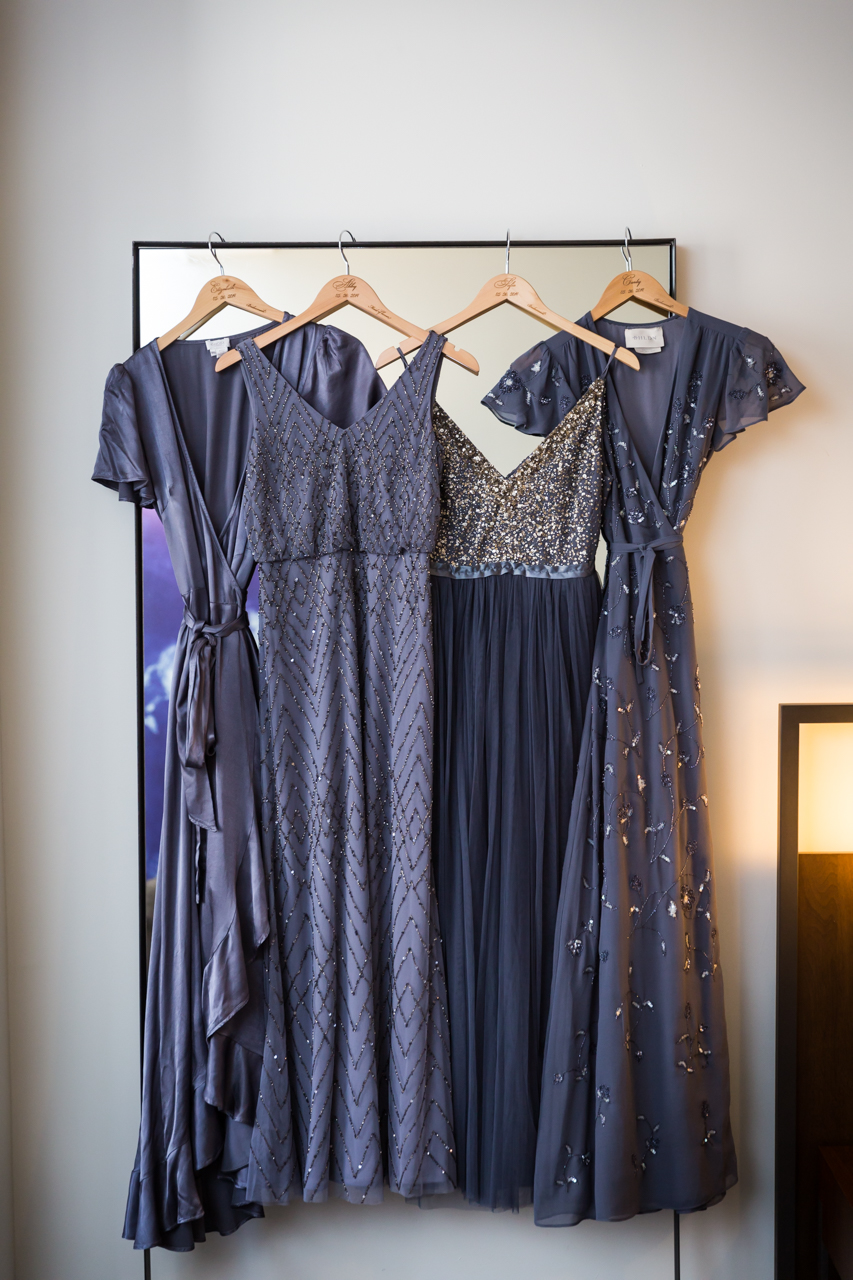 Grey bridesmaid dresses hanging up at a Central Park Conservatory Garden wedding