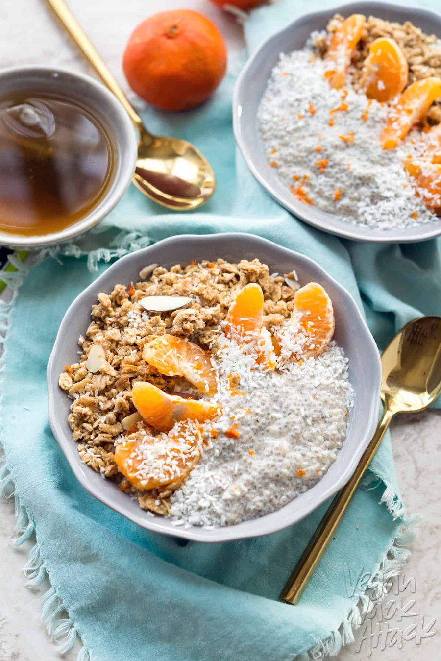 dreamy tangerine chia pudding with granola in a lilac-colored bowl with teal linen