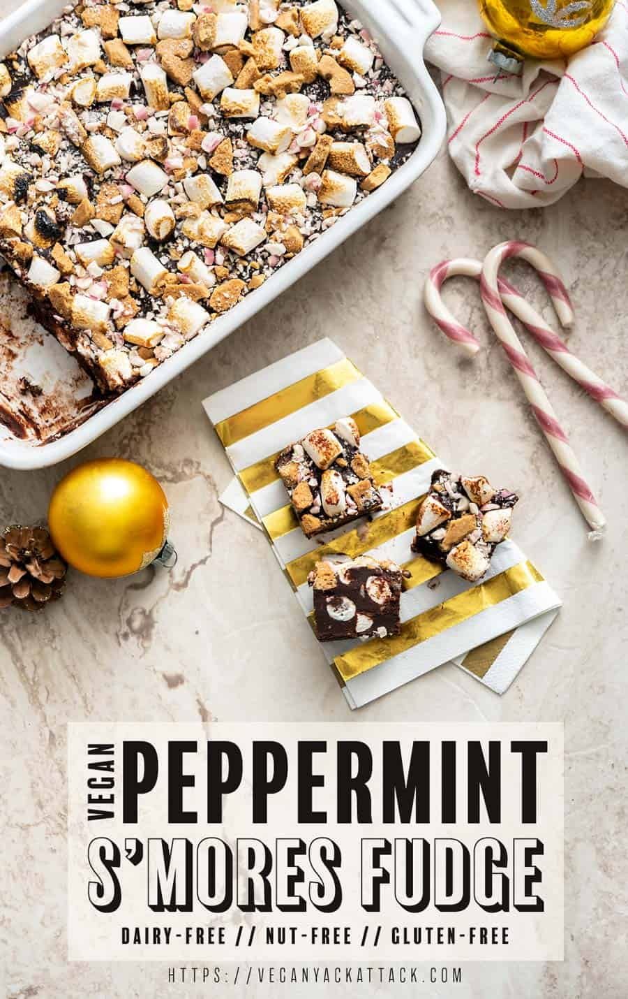 Pieces of vegan peppermint s'mores fudge cut out of the dish and on a napkin, with recipe title text