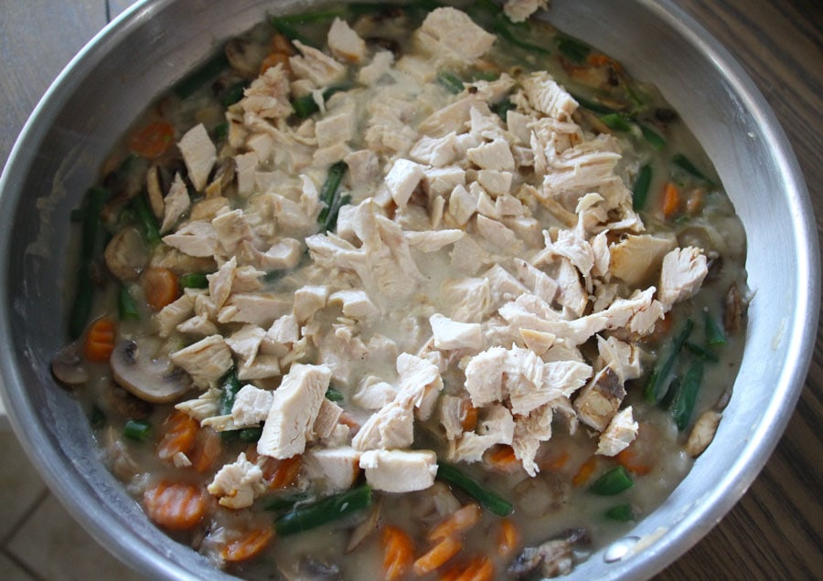 Add fat-free half and half, chicken, green beans, thyme, salt and cayenne.