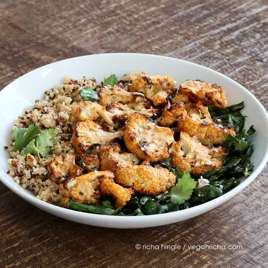 This delicious Quinoa Cauliflower bowl is filled with grains, lightly cooked greens & Sriracha Sauce, so it's healthy AND delicious! Vegan, soy-free