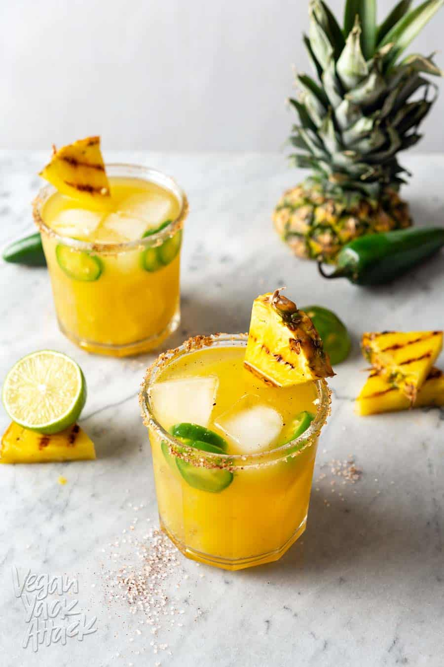 These Charred Pineapple Jalapeño Margaritas are better than any of their predecessors and unique in their own way! Try out this recipe to cool down, while also bringing the heat. #cocktails #margaritas #pineapple #recipe #jalapeno