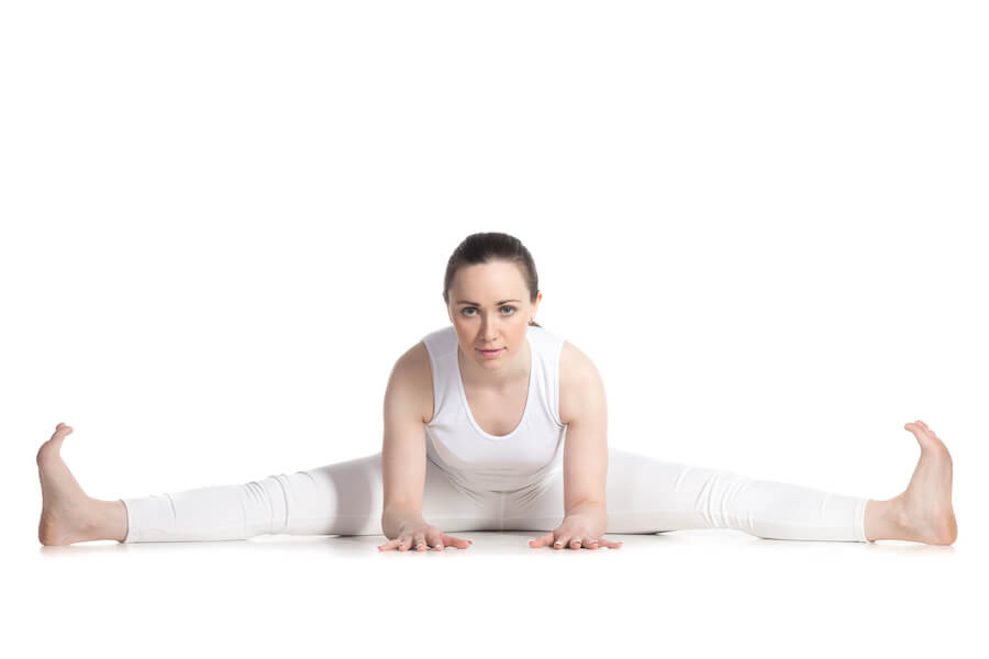 Wide-Angle Seated Forward Bend pose - yoga poses for flexibility