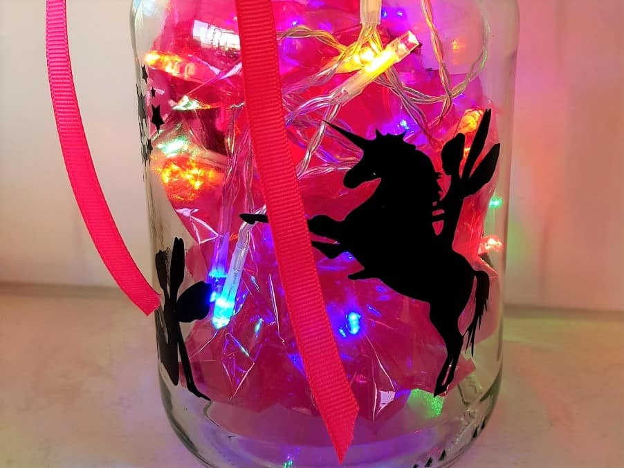 Fairy light jar with pink cellophane and lights