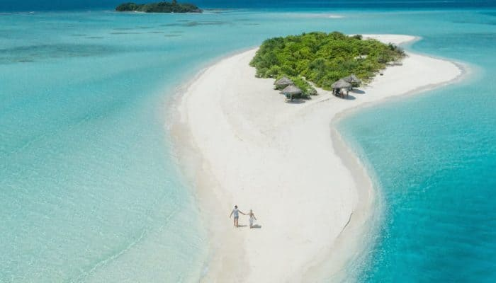 A beach experience, barefoot and in love in sandy paradise