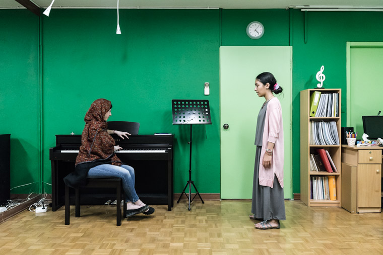 ranian female vocalist Sayeh giving vocal lesson to a young girl at her own music school.