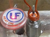Induction brazing of stainless steel pin to a steel base after heating