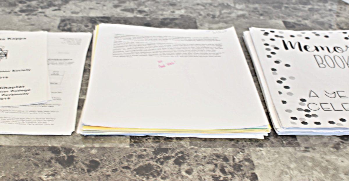 organize kids school papers-stacks of school papers