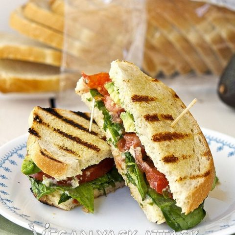 A Grilled Sourdough Sammie with tangy jalapeño lime aioli and fresh summer produce stacked inside.