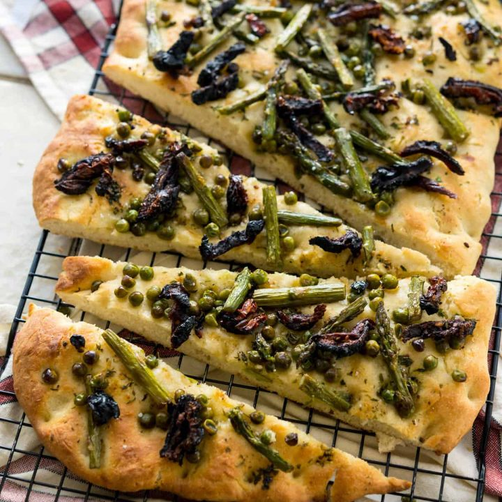 Spring Asparagus Herbed Focaccia with umami-rich sundried tomatoes, and a garlic herb-infused oil? Yes, please! Vegan, Soy-free, Nut-free