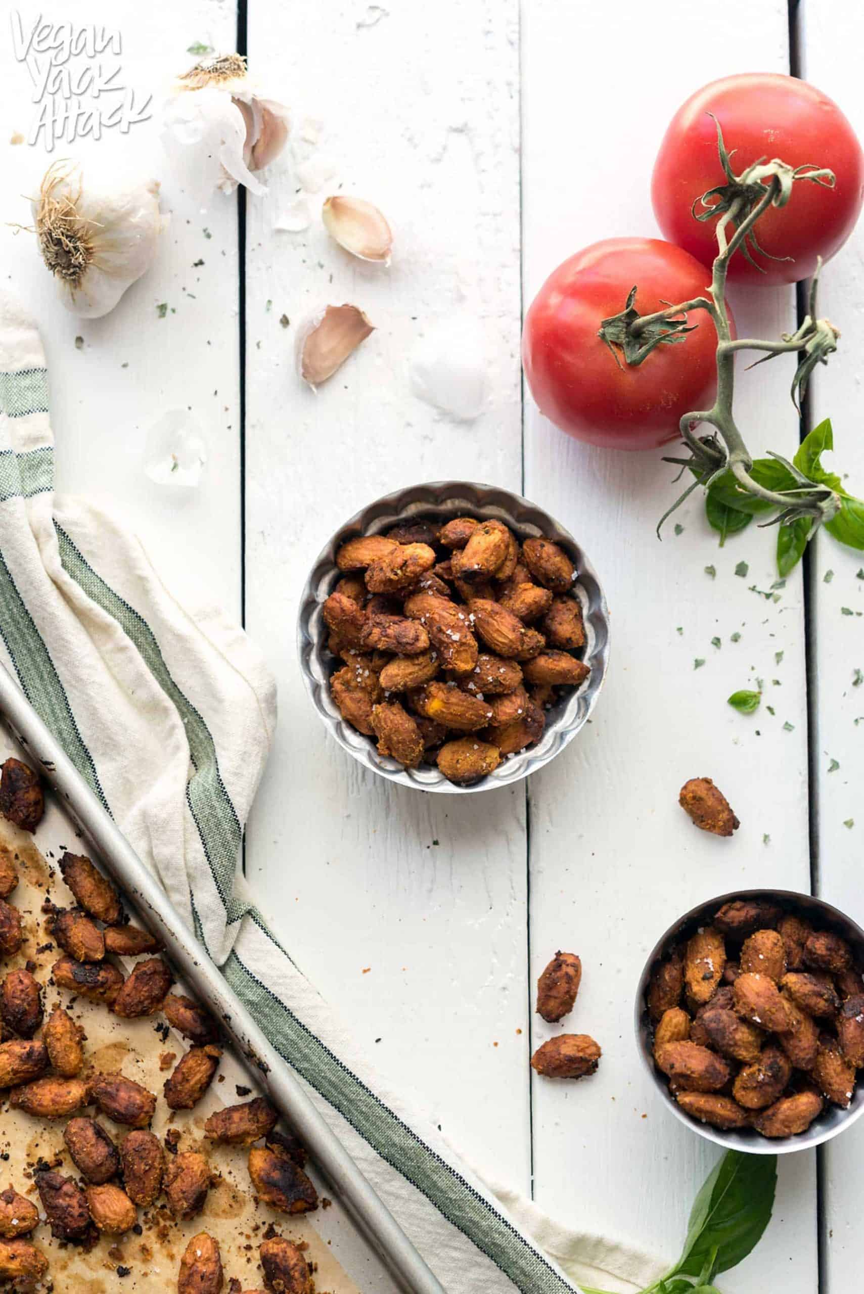 Image of pizza-roasted almonds in two small bowls on a white table