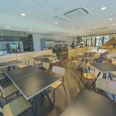 Empty Cafe Of Tables And Chairs Available For Hire.