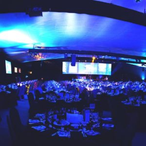 Round Tables Set Up Inside The Venue For A Gala Dinner.