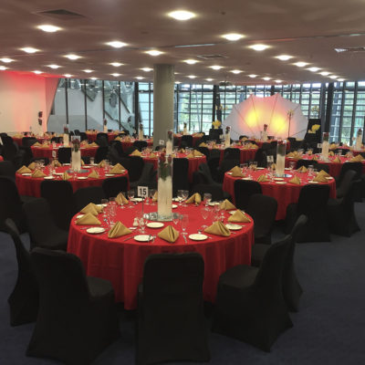 Large Function Room Set Up With Tables And Chairs In Banquet Style.