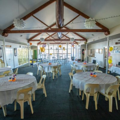 Casual Function Set Up With Round Tables And Chairs At Swan River Rowing Club Riverside Venue