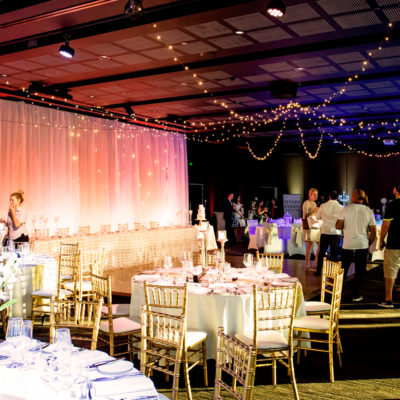 Few Guests Inside The Function Room With Long Table And Banquet Style Setting