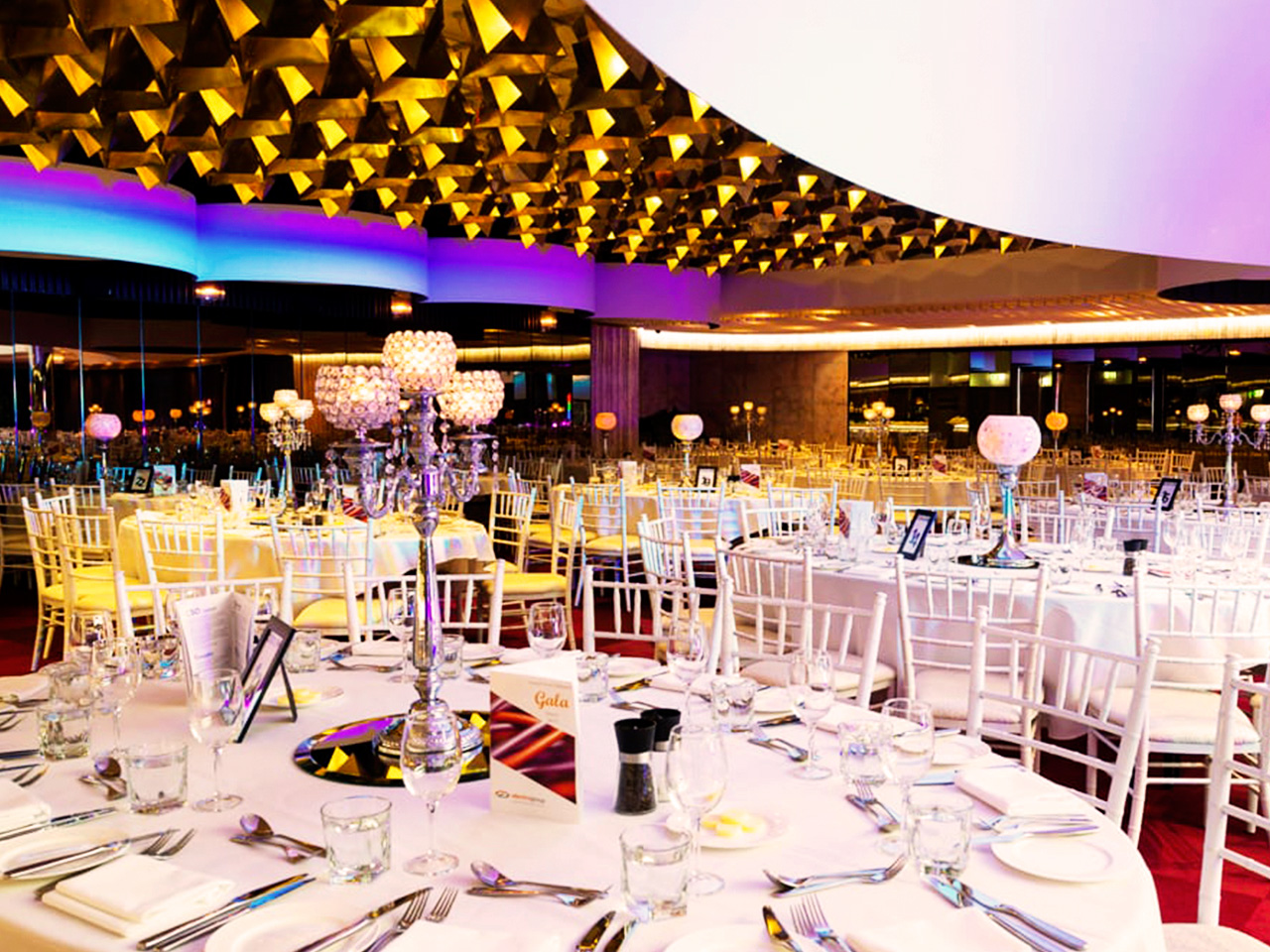 Round white tables set for an event