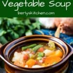 A brown and white ceramic bowl full of Instant Pot vegetable soup.
