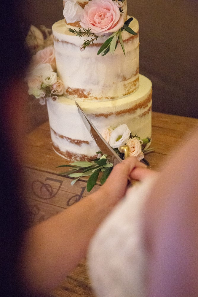 photo of brides cutting the wedding cake