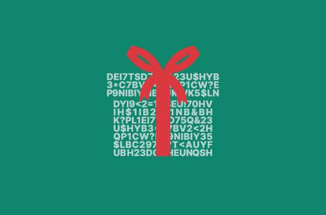 Gift present wrapped in a red bow and encrypted wrapping paper.