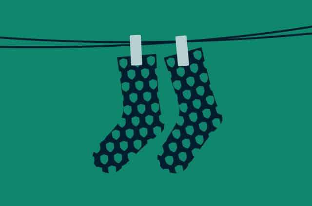 Socks with a shield pattern hanging on a line.