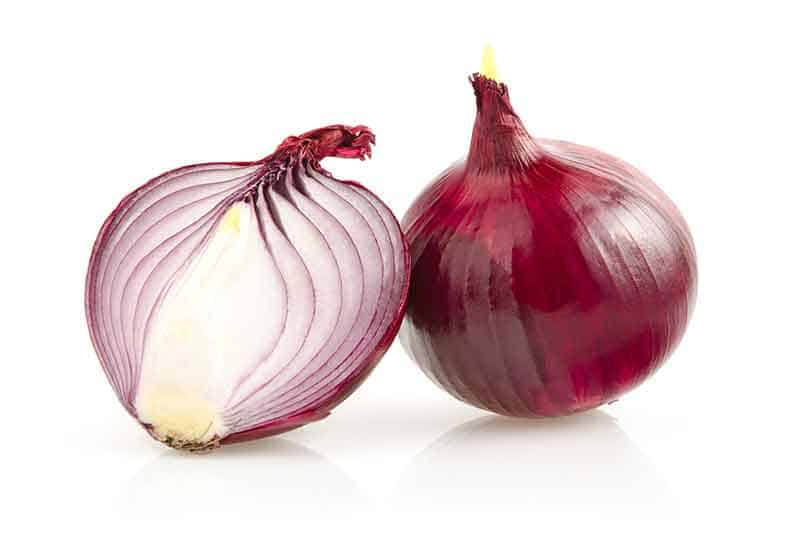 photo of a red onion cut in half