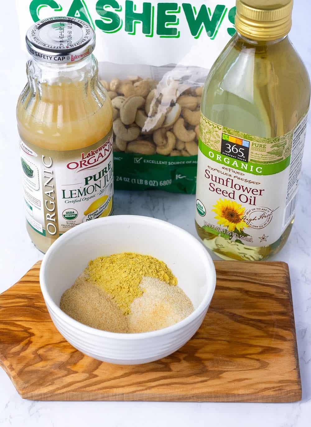 vegan mayo ingredients, lemon juice, sunflower oil, cashews, yeast flakes, onion powder, garlic powder, salt, sugar
